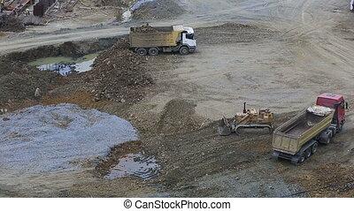 construction vehicle 2 - construction vehicle dumping rock