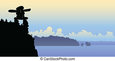 Inukshuk Overlook - An Inukshuk on a cliff looking over a...