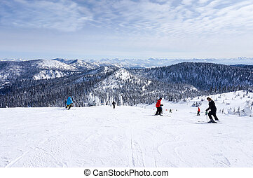 The Big Mountain at Whitefish, Montana - Skiers descend from...