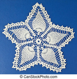 Doily quater - Handmade doily on blue background