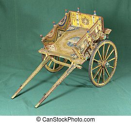 Sicilian cart - Old small sicilian cart on green background