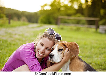 Woman with dog - Happy young woman with her beagle dog in...