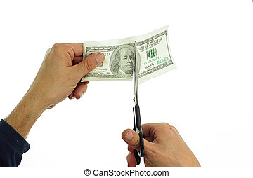 cutting dollar - hands cutting 100 dollar note
