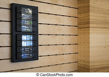 black switches for light control on wooden acoustic wall