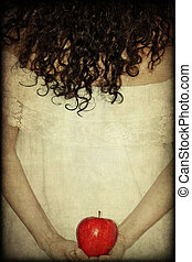Woman - Portrait of woman in white dress holding a red apple...