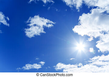blue sky with white clouds and the sun - background from the...