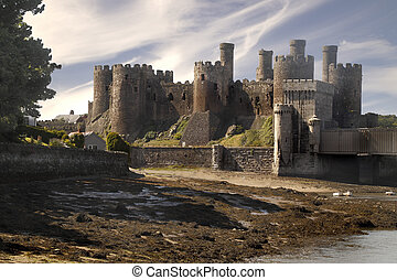 Conwy Castle was built in the thirteenth century on the...