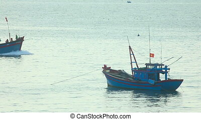 Fishing boats - Fishing vessel coming back to port.
