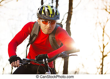 Mountain biker - cyclist man riding mountain bike on outdoor...
