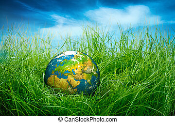 Concept - Earth Day - Globe lies on green grass. Concept -...