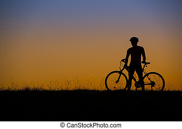 Mountain biker - Silhouette of mountain biker in sunset on...