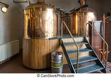 brewing - Line of two traditional brewing vessels in...