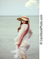 portrait of young lady by the sea