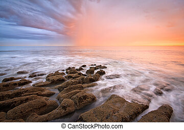 Seascape, Hastings. - Beach rock formations and an evening...