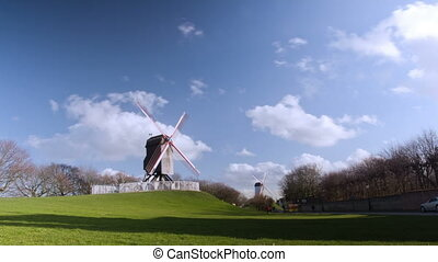 Beautiful wooden wind mill Brugge, Belgium. Time lapse.