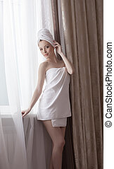 Sexy brunette posing in towel, after taking shower - Image...