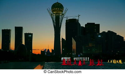 Evening cityscape - Lighted fountain in front of famous...