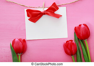 Message card with red tulips