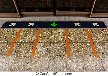 MRT station. - MRT station platform edge. Painted waiting...