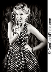 exquisite - Pretty pin-up woman singing with microphone over...