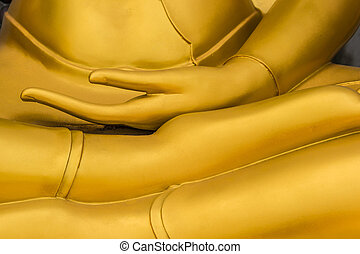 Close up golden hand of buddha statue