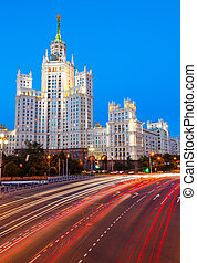 Moscow, Stalin skyscraper and road traffic on the embankment...