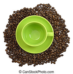 Green cup and saucer in the coffee beans. Isolated on white...