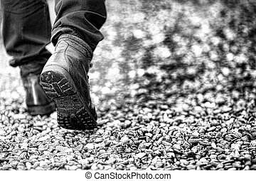 Walking on the rain - Close up of a person walking in the...