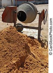 Cement mixer - orange cement mixer at a construction site