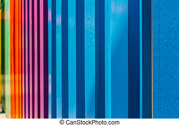 Wooden painted fence. - Colourful rows of a wooden painted...
