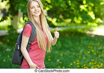 Smiling woman student with backpack - Portrait of young...