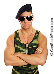Portrait of young military man at sunglasses on white...