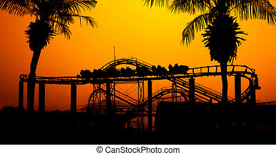 Roller coaster - Roller coaster silhouette at sunset in the...