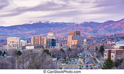 Cityscape with hills and cars - Sunset on the city of Boise...