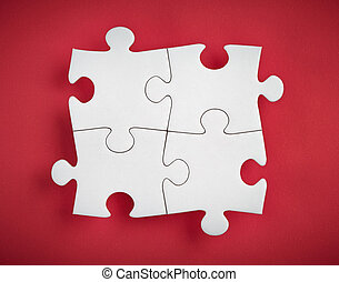 puzzle pieces - four puzzle pieces on red background