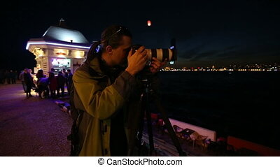 photographer shooting at night city - professional...