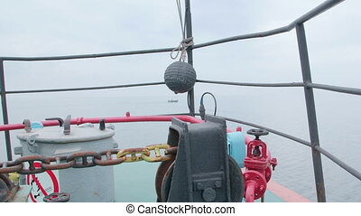 Bow of commercial fishing boat in the misty sea