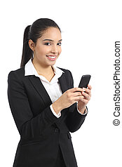 Arab business woman using a smart phone and looking at...