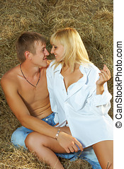 couple on hayloft - Happy smiling seductive couple...