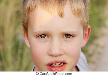 Outdoor portrait of 6 years old boy