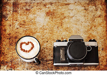 vintage camera and cup of coffee