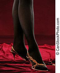 Feminine legs in loafers.
