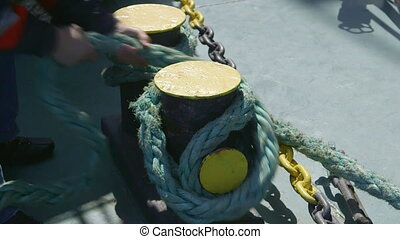 Men hands moored vessel close-up