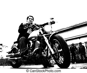 Biker Sergey Illarionov - Biker Sergey Illarionov sits on...
