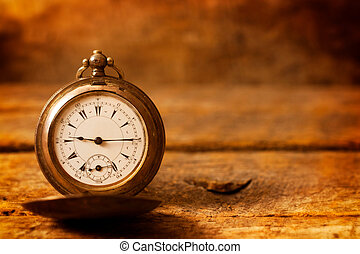 Old pocket watch - Old golden pocket watch on the wooden...