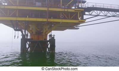 Automated gas production offshore platform in the misty sea