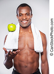 Enjoying healthy lifestyle. Young muscular African man with...
