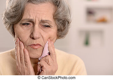 Senior woman with tooth pain - Elderly nice woman having bad...