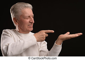 Aged man pointing - Mature man pointing with his fingers on...