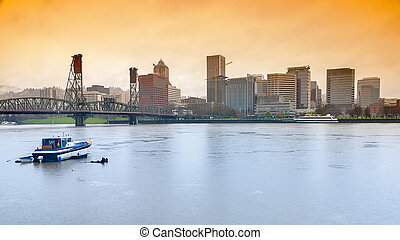 Portland skyline on a rainy day - Boat parked in a river at...